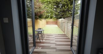 View to the garden from the back door of a refurbished house